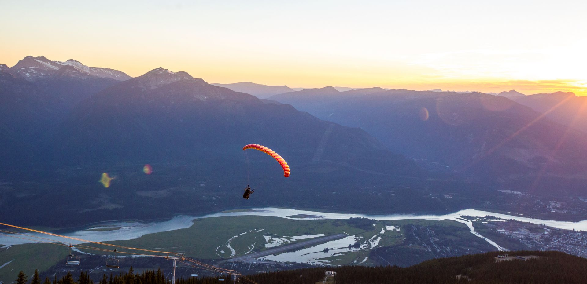A man hang gliding in Revelstoke, BC