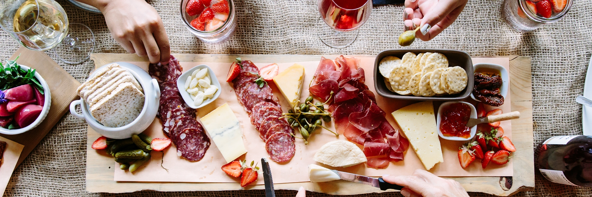 A group enjoying a charcuterie board.