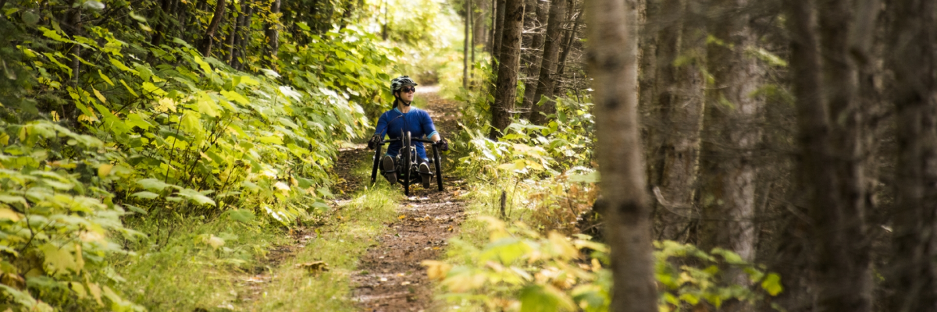 A woman in a reclining wheelchair in British Columbia