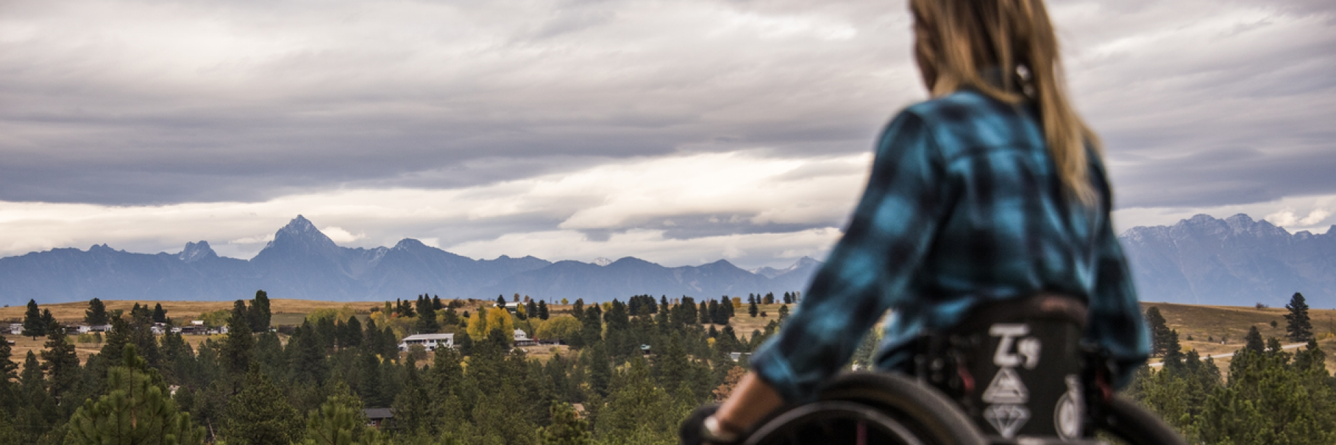 A woman in a wheelchair looking out over BC